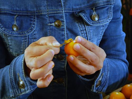 peeling kumquat in our class in Hoi An