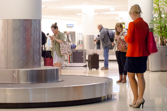 Waiting at baggage claim. See you soon.