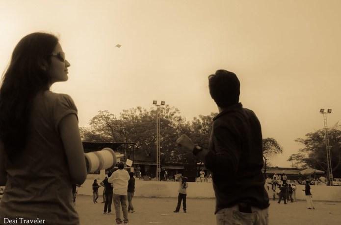 kite flying team girl holding charkhee
