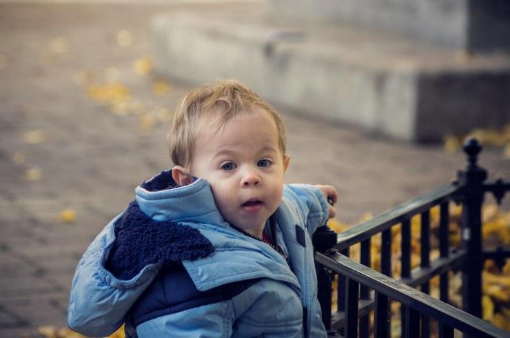Micah enjoying the fall leaves