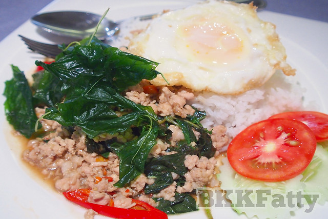 thai basil stir fry with fried egg at Naj