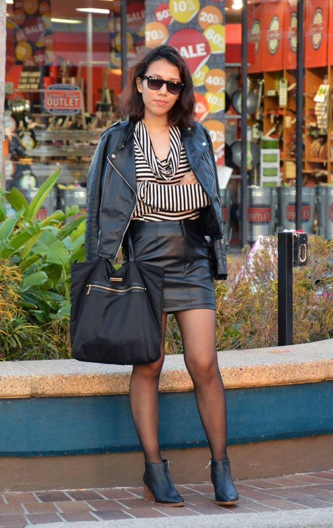 black leather jacket, leather skirt, striped turtleneck sweater, black ankle boots