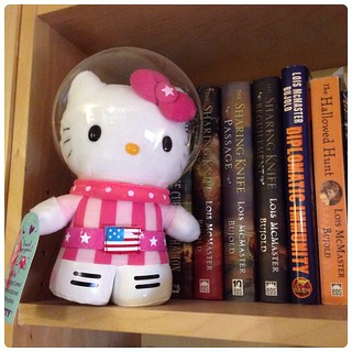 Astronaut Hello Kitty tours the lady SFF in my library, starting with Lois McMaster Bujold.