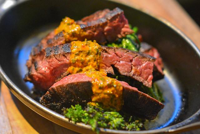 white oak grilled skirt steak grilled broccolini, red chimichurri