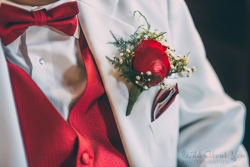 white tux with red bowtie and vest