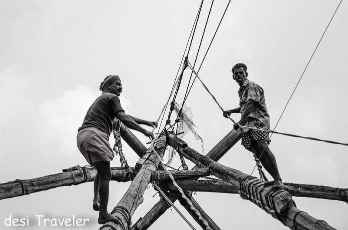 Fishermen working on Chinese Fishing nets Fort Kochi Cochin
