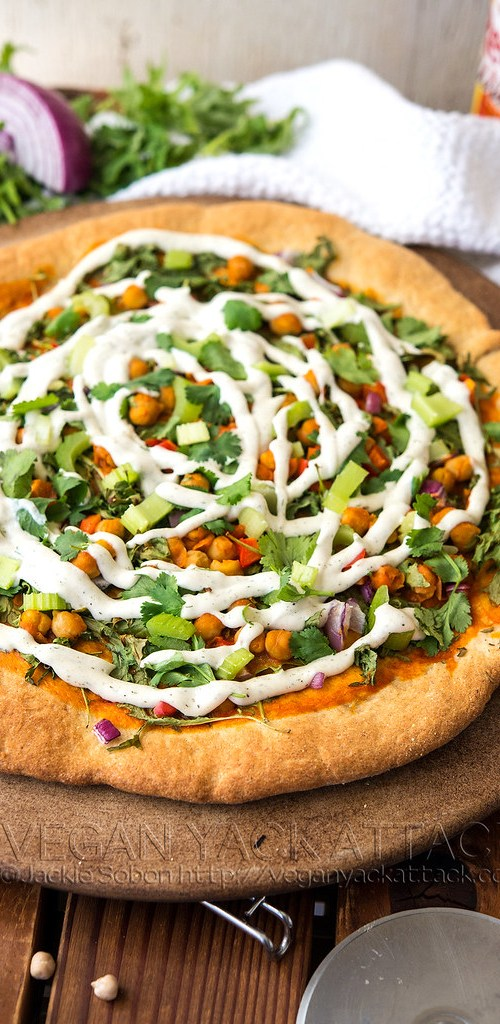 Impossible to resist, this Buffalo Chickpea Ranch Pizza beats them all! Oh, and it's VEGAN! Make this for a supremely tasty dinner, or bring it to a party.