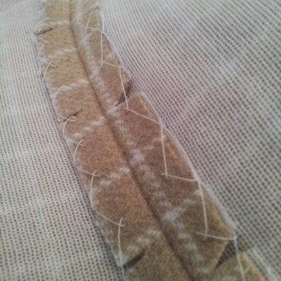 notched and catch stitched collar seam