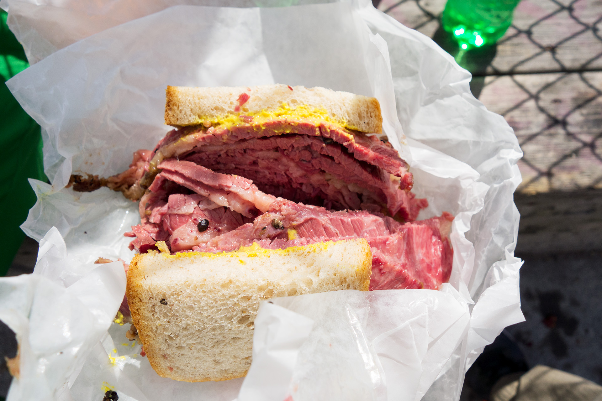 The smoked meat sandwich with mustard from Schwartz's Deli.