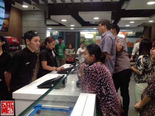 Ordering at the counter of Triple-O's by White Spot SM Megamall