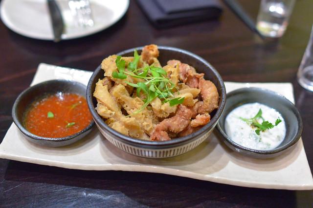 "Fried Tripe ""Calamari"" & Small Intestine Chicharrón Cilantro Garlic Yogurt Dip, Issan Dressing"