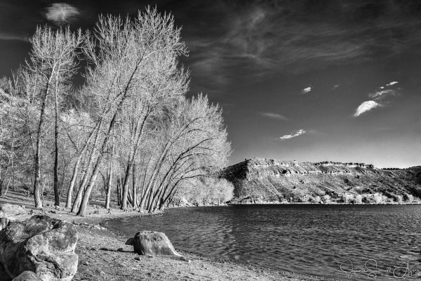 2017 WEEK 11: STORYTELLING – IN MY TOWN by Jeanie Sumrall-Ajero. An orange filter used during the conversion to B&W helped to brighten the red sandstone cliffs and the red dirt in the foreground and at the same time darkened the blue sky to add contrast to an otherwise flat looking scene.