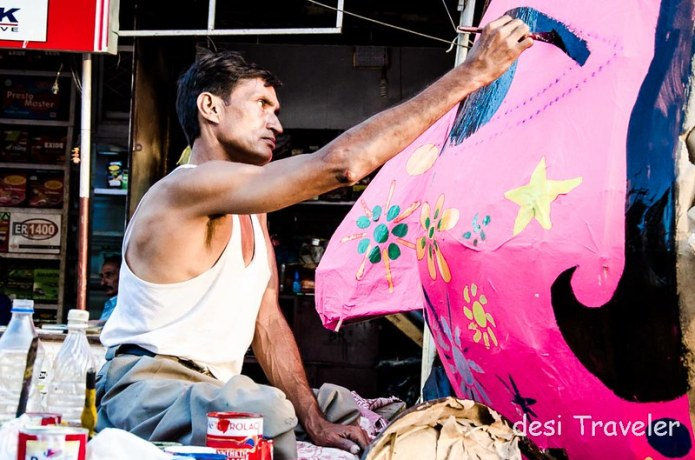 An artist gives finishing touches to a Ravana
