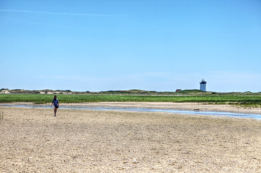 Glinda hiking out to Wood End Lighthouse, Cape Cod.