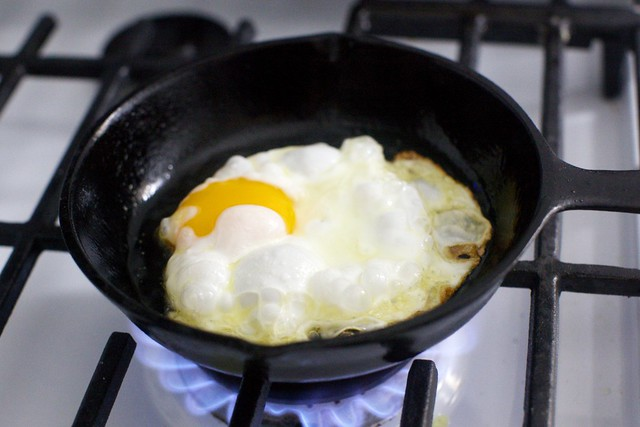 crispy egg, blowing up in the pan