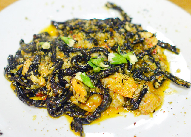 Strozzapreti Nero di Seppia. squid ink. lobster. clams. romanesco broccoli. chilies. lemon zest.