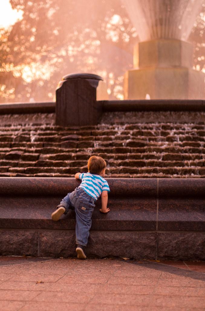 Micah climbing the Fountain