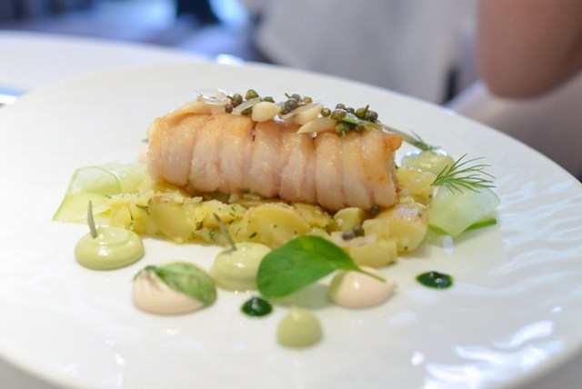 Roasted fillet of skate with razor clams, lovage, taramasalata, Jersey Royals and beurre noisette