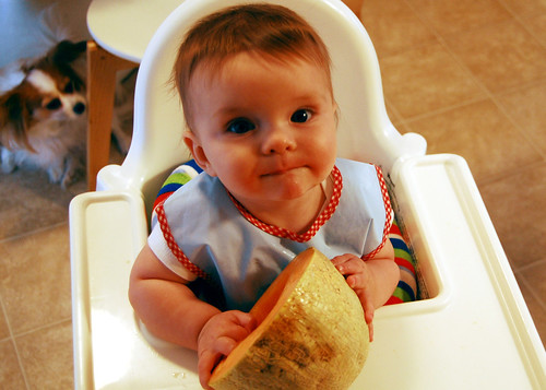 Her first taste of cantaloupe.