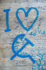Blue communist graffiti on marble wall
