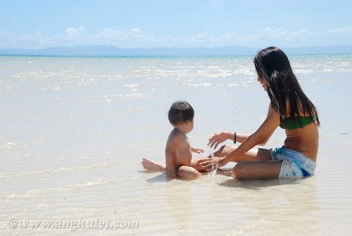 Mother and child playing in the sand; Manlawi, Caramoan, Camarines Sur