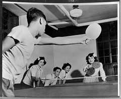 Boy and girl play ping-pong, circa 1950