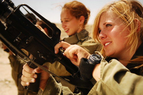 Female Soldiers Unloading their Weapons