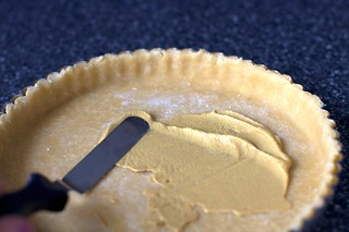 spreading mustard in tart shell