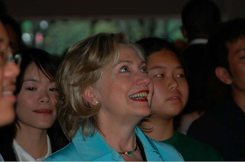 Secretary Clinton Observes Action at USA Pavilion