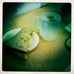 arty egg sandwich and latte