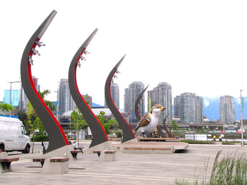 Olympic Village in Vancouver's Southeast Falsecreek, plaza, street lamps and bird sculpture