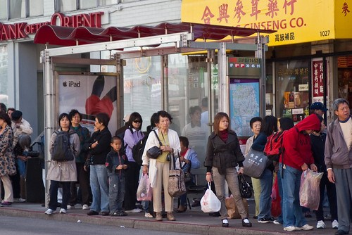 11623 Waiting with familiar Chinatown grocery bags in hand