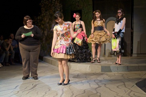 A student shows off her work to the judges in the 2010 UMM Fashion Trashion show