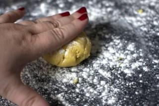 pressing down the dough