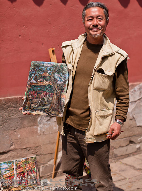 Oil Painting artist Hong Yi holding the work we bought in Forbidden City, 故宫, Beijing, China