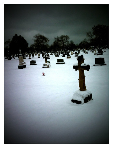 Stark beauty of snowy cemetery