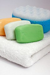 Colorful bars of soap on white towel