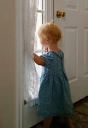 Anxious child at window