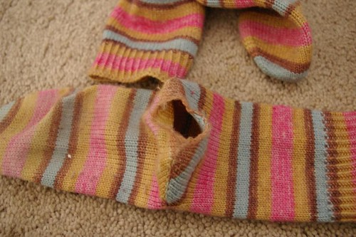 Hole in my only Yarntini self-striping socks!