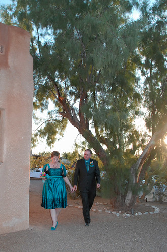 Bix escorting me to the front of the chapel before the ceremony begins