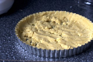 pressing in the cornmeal crust