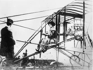 Blanche Stuart Scott being taught to fly by her mentor, Glen Curtiss, the aviation pioneer, in Hammondsport, New York, circa 1910.  Scott is credited with being the first woman to pilot an airplane in the United States.