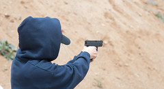 Masked Person With A Gun