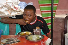 Man eating pounded yam in a canteen