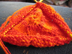 red and orange hat on double pointed needles