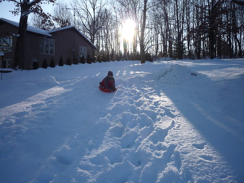Issac sled riding.