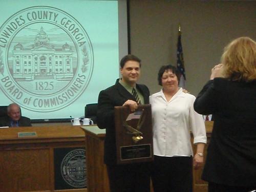 Deb Cox congratulates Aaron Kostyu