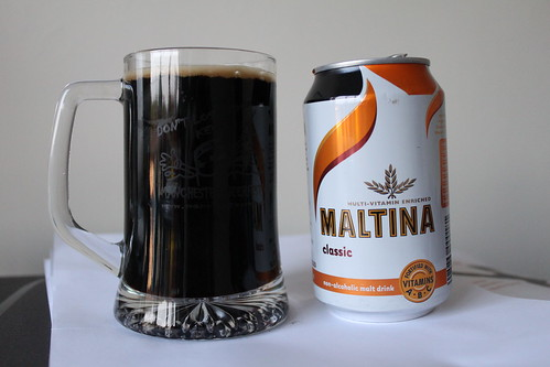 Maltina can and poured into a glass