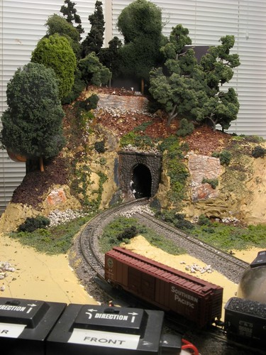 Long front view of completed tunnel scenery on the mini layout