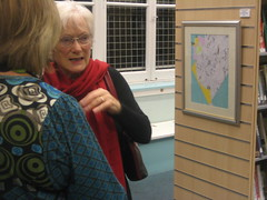 Jill Alexander, selector, with Susan Wood discussing Suzanne Rees Glanister's painting